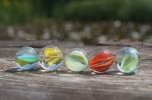 Playing marbles at camp