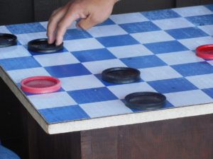 kids playing checkers at camp