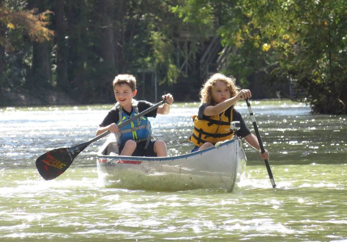 Children Canoeing With Paddle With Style